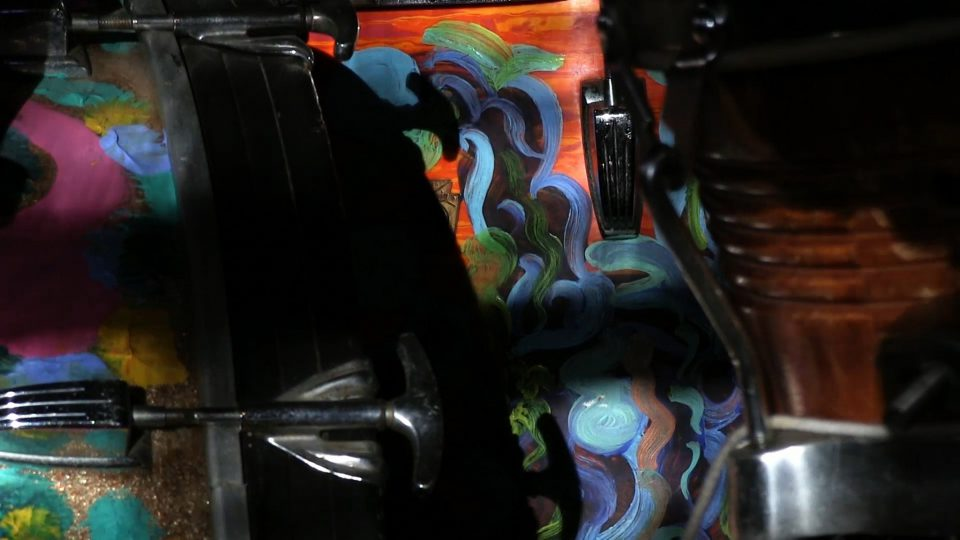 Sunlight plays across a handpainted drum set in Milford Graves's studio