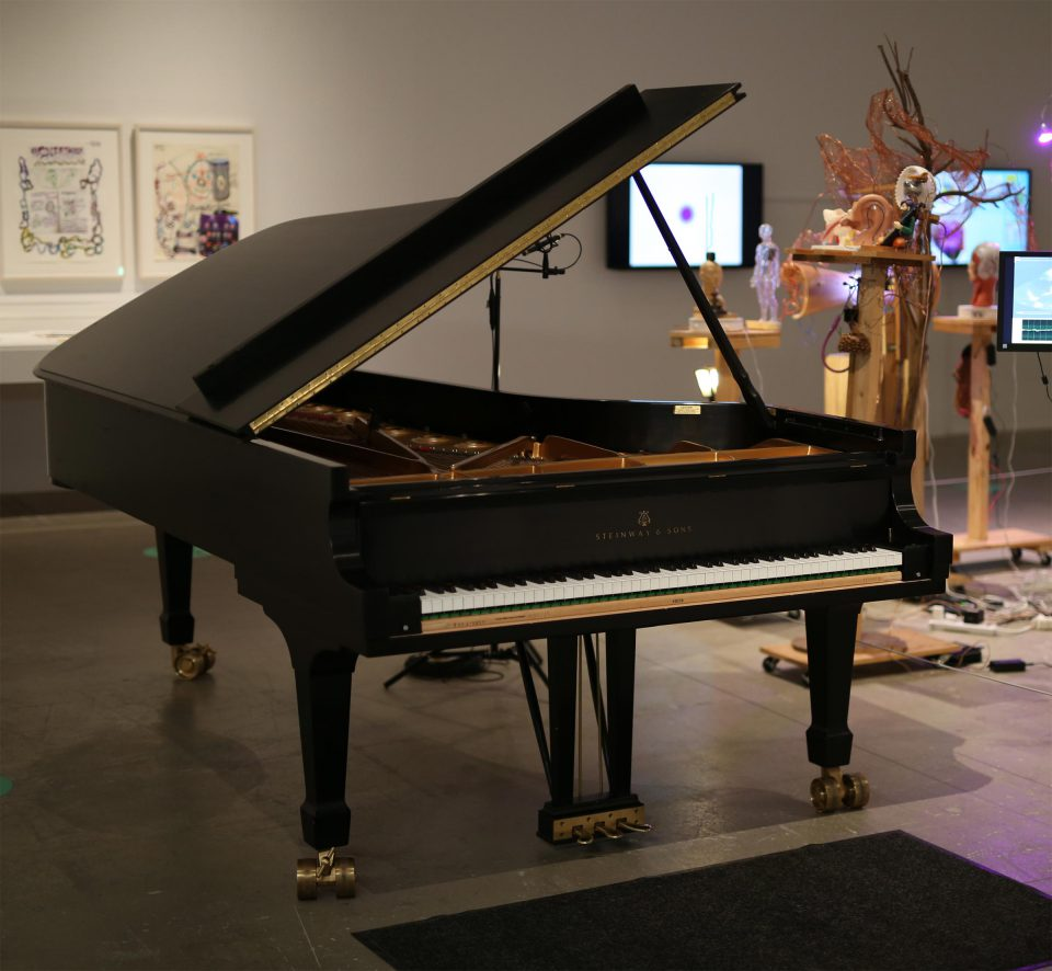 grand piano in a gallery alongside Milford Graves: A Mind-Body Deal exhibition installation
